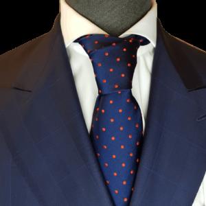 Blaue Krawatte mit roten Punkten