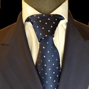 Dunkelblaue Krawatte mit hellblauen Punkten