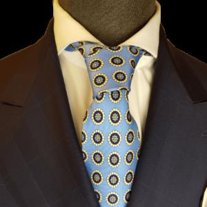 Eisblaue Krawatte mit gelben Emblemen